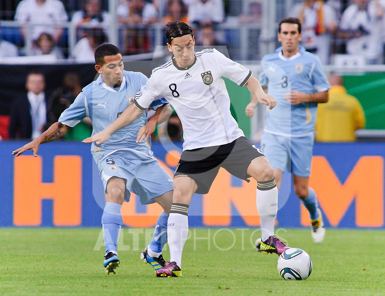 29.05.2011, Rhein-Neckar-Arena, Sinsheim, GER, LS FSP, Deutschland (GER) vs Uruguay (UY), im Bild Walter Gargano of Uruguay and Mesut Oezil (L) of Germany  during the Football Friendly Ship betweem Germany and Uruguay  for the Rhein-Neckar-Arena in Sinsheim, Germany, 2011/05/29, EXPA Pictures © 2011, PhotoCredit: EXPA/ nph/  Roth       ****** out of GER / SWE / CRO  / BEL ******