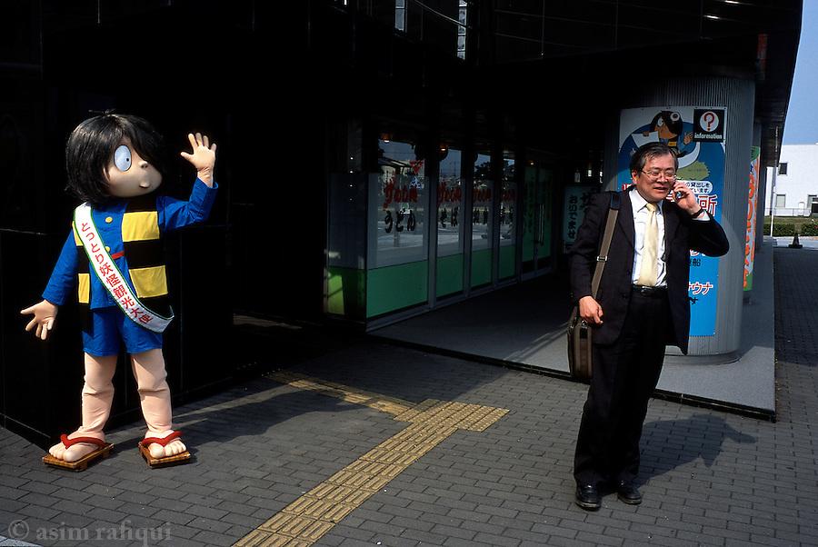 A Kitaro character entertains on the streets of Sakaiminato.
