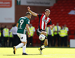 Chris Basham of Sheffield Utd and Neal Maupay of Brentford during the English Championship League match at Bramall Lane Stadium, Sheffield. Picture date: August 5th 2017. Pic credit should read: Simon Bellis/Sportimage
