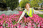 Pictured is Margaret Curtin weeding one of the flower beds in Killarney.