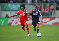 25 September 2010:  Toronto FC midfielder Julian de Guzman #6 and San Jose Earthquakes midfielder/forward Geovanni #77 in action during a game between the San Jose Earthquakes and Toronto FC at BMO Field in Toronto..San Jose Earthquakes won 3-2...
