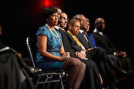 Washington, DC - January 2, 2015: Muriel Bowser (l)listens to a speaker before taking the mayoral oath of office during the 2015 inauguration ceremony held at the Washington Convention Center, January 2, 2015. Bower became the second female mayor in the history of the District of Columbia.  (Photo by Don Baxter/Media Images International)