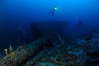 scuba diver hovers over bow sprit of ship wreck Mairi Bahn, aka Windjammer, Bonaire, Netherlands Antilles, Caribbean, Atlantic