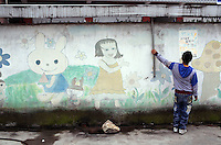 Cartoon characters painted on a wall outside of a school in a small town in western Sichuan Province, China.