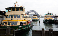 14 SEP 2009 - SYDNEY, AUS - A ferry comes into dock at Circular Quay in Sydney Cove (PHOTO (C) NIGEL FARROW)