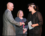 Western Nevada College Dean of Student Services John Kinkella and Nancy Olsen congratulate graduate Willow Bartels during a ceremony as more than 100 students received their High School Equivalency during a Western Nevada College ceremony in Carson City, Nev., on Monday, June 19, 2017. <br /> Photo by Cathleen Allison/Nevada Photo Source