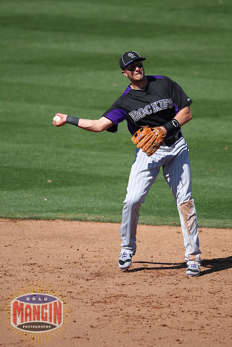 PEORIA, AZ - MARCH 02:  Troy Tulowitzki of the Colorado Rockies makes a play at shortstop during the spring training game between the Colorado Rockies and the San Diego Padres on March 2, 2011 at Peoria Sports Complex in Peoria, Arizona. Photo by Brad Mangin