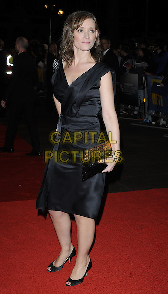 "ANNE-MARIE DUFF.The closing gala premiere of ""Nowhere Boy"" during the The Times BFI London Film Festival, Odeon Leicester Square, London, England..October 29th, 2009 .LFF full length black dress wrap brooch clutch bag sleeveless .CAP/CAN.©Can Nguyen/Capital Pictures."