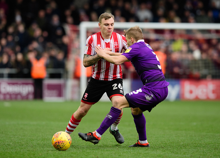 Lincoln City's Harry Anderson vies for possession with Grimsby Town's Sebastian Ring<br /> <br /> Photographer Chris Vaughan/CameraSport<br /> <br /> The EFL Sky Bet League Two - Lincoln City v Grimsby Town - Saturday 19 January 2019 - Sincil Bank - Lincoln<br /> <br /> World Copyright &copy; 2019 CameraSport. All rights reserved. 43 Linden Ave. Countesthorpe. Leicester. England. LE8 5PG - Tel: +44 (0) 116 277 4147 - admin@camerasport.com - www.camerasport.com