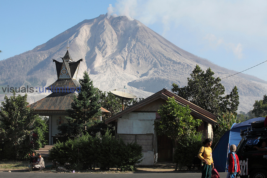 Sinabung Volcano looming threateningly over nearby communities, Indonesia