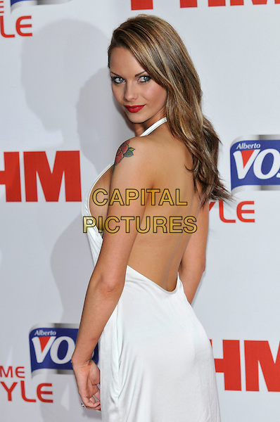 Jessica-Jane Clement.FHM 100 Sexiest Women in the World 2012 Party, at Proud Cabaret, Mark Lane, London, England. 1st May 2012.half length white dress side boob cleavage tattoo backless looking over shoulder .CAP/PL.©Phil Loftus/Capital Pictures.