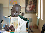 A girl reads in class at the Loreto Secondary School in Rumbek, South Sudan. The school is run by the Institute for the Blessed Virgin Mary--the Loreto Sisters--of Ireland.