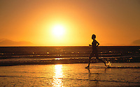 FEB 1999 - THE STRAND, CAPE TOWN, SOUTH AFRICA - Karen Gordon runs along the beach at sunset. (PHOTO (C) NIGEL FARROW)
