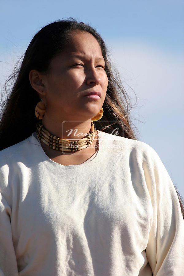 A young Native American Indian Woman looking into the sun in South Dakota