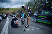 Johann Van Zyl (SAF/MTN-Qhubeka) stops at the top of the 1st climb, the Côte de La Roche-en-Ardenne (2900m/5.6%), because of a mechanical where a team car is posted for such occasions. The staffer immediately jumps into action to set him on his way asap.<br /> <br /> 101th Liège-Bastogne-Liège 2015