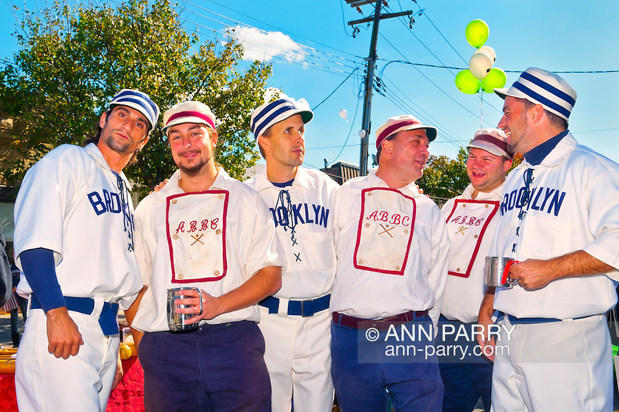 In vintage base ball uniforms, baseball team members of Atlantic Base Ball Club, a member of the Vintage Base Ball Association and Mid Atlantic Base Ball League, at Merrcik Street Fair, in Merrick, New York, on October 22, 2011. Editorial