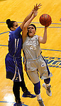 BROOKINGS, SD - NOVEMBER 18:  Ellie Thompson #45 from South Dakota State University takes the ball to the basket against Alexis Akin-Otiko #45 from Creighton in the first half of their game Tuesday night at Frost Arena in Brookings. (Photo by Dave Eggen/Inertia)
