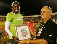 Kernia Sinclair accepting her award after winning the 800m at the Jamaica International Invitational Meet held at the National Stadium on Saturday, May 2nd. 2009. Photo by Errol Anderson,The Sporting Image.net