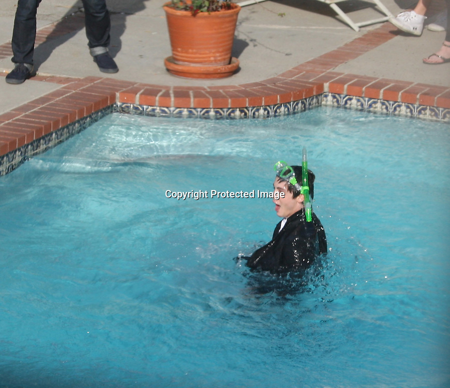 .3-18-2010   Exclusive ...Logan Lerman swimming in a pool wearing a snorkel & suit on for a Teen Vogue Magazine photo shoot in Los Angeles California. Logan also bounced a lighting bolt volley ball on his knee & wore a pair of sunglasses with L.A written on them  ..Abilityfilms@yahoo.com.805-427-3519.www.AbilityFilms.com