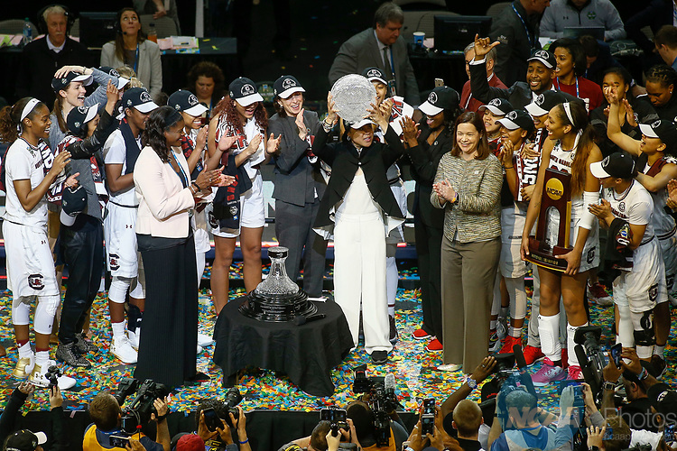 DALLAS, TX - APRIL 2: Head coach Dawn Staley of the South Carolina Gamecocks lifts the WBCA coaches trophy during the 2017 Women's Final Four at American Airlines Center on April 2, 2017 in Dallas, Texas. (Photo by Timothy Nwachukwu/NCAA Photos via Getty Images)