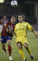 08 November 2006: CSD Municipal's Mario Rodriguez, left, and Columbus Crew's Stefani Miglioranzi chase a loose ball during the second half in Columbus, Ohio.<br />