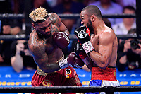 """Fairfax, VA - May 11, 2019: Julian J-Rock"""" Williams and Jarrett """"Swift"""" Hurd exchange punches during Jr. Middleweight title fight against at Eagle Bank Arena in Fairfax, VA. Julian Williams defeated Hurd to take home the IBF, WBA and IBO Championship belts by unanimous decision. (Photo by Phil Peters/Media Images International)"""