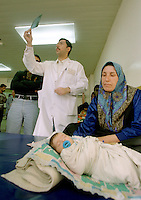 "(February 1998) Pediatrician , doctor Yaser Raouf, at the Saddam Hospital in Baghdad is looking at x-ray of a orphan child found in a street and taken to the hospital. <br /> Due to UN sanctions the hospital was lacking many medicines, and the civilians suffered due to lack of food as well. <br />  Former U.N. Humanitarian Coordinator in Iraq Denis Halliday estimated the resulting deaths : ""Two hundred thirty-nine thousand children 5 years old and under"" as of 1998.<br /> <br /> The sanctions against Iraq were a near-total financial and trade embargo imposed by the United Nations Security Council on the Iraqi Republic.<br /> <br /> <br /> ©Fredrik Naumann/Felix Features"