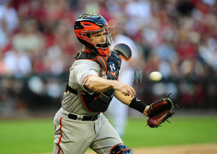Apr. 6, 2012; Phoenix, AZ, USA; San Francisco Giants catcher Buster Posey throws to first base in the sixth inning against the Arizona Diamondbacks during opening day at Chase Field. The Diamondbacks defeated the Giants 5-4. Mandatory Credit: Mark J. Rebilas-