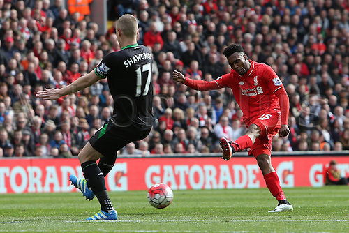 10.04.2016. Anfield, Liverpool, England. Barclays Premier League. Liverpool versus Stoke. Daniel Sturridge of Liverpool  fires a shot past Ryan Shawcross of Stoke City.