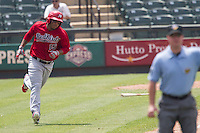 Memphis Redbirds outfielder Oscar Taveras #15 rounds first base after smacking a home run during the Pacific Coast League baseball game against the Round Rock Express on April 27, 2014 at the Dell Diamond in Round Rock, Texas. The Express defeated the Redbirds 6-2. (Andrew Woolley/Four Seam Images)