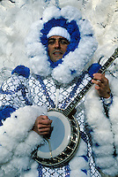 A man in the Fancy Division is dressed in a blue costume of feathers marching with bango in the Mummers Day Parade on New Years Day, Philadelphia, Pennsylvania..