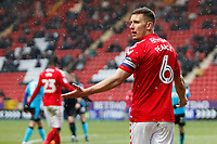Jason Pearce of Charlton FC questions the decision during the Sky Bet League 1 match between Charlton Athletic and Fleetwood Town at The Valley, London, England on 17 March 2018. Photo by Carlton Myrie.