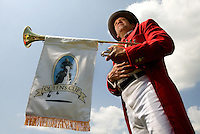 A bugle player waits to perform during the Queen's Cup Steeplechase in Mineral Springs, NC.