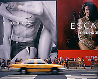 "Out takes from ""The Harvard Design School Guide to Shopping"" published by Tashen. Crowds walk down Broadway in front of massive advertisements that cover-up construction projects. New York 2000"
