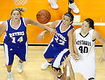 SIOUX CITY, IA - MARCH 13, 2009 --   Amber Peters #14 and Bekah Basinger #22 of Bethel College battle for rebounding position with Emily Christen #40 of Morningside College during their game at the 2009 NAIA DII Women's Basketball National Championship at the Tyson Events Center. (Photo by Dick Carlson/Inertia)