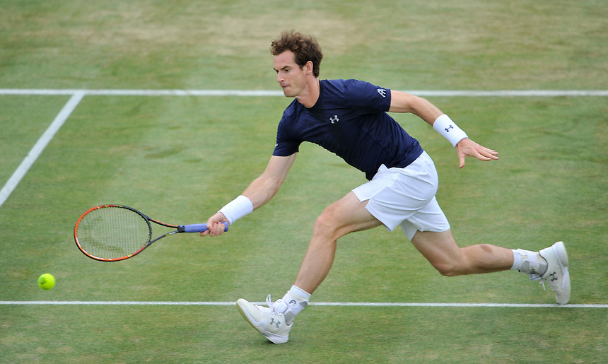Andy Murray in action against Gilles Simon in the third singles rubber match today<br /> <br /> Photographer Ashley Western/CameraSport<br /> <br /> International Tennis - 2015 Davis Cup by BNP Paribas - World Group Quarterfinals - Great Britain v France - Day 3 - Sunday 19th July 2015 - Queens Club - London<br /> <br /> &copy; CameraSport - 43 Linden Ave. Countesthorpe. Leicester. England. LE8 5PG - Tel: +44 (0) 116 277 4147 - admin@camerasport.com - www.camerasport.com.