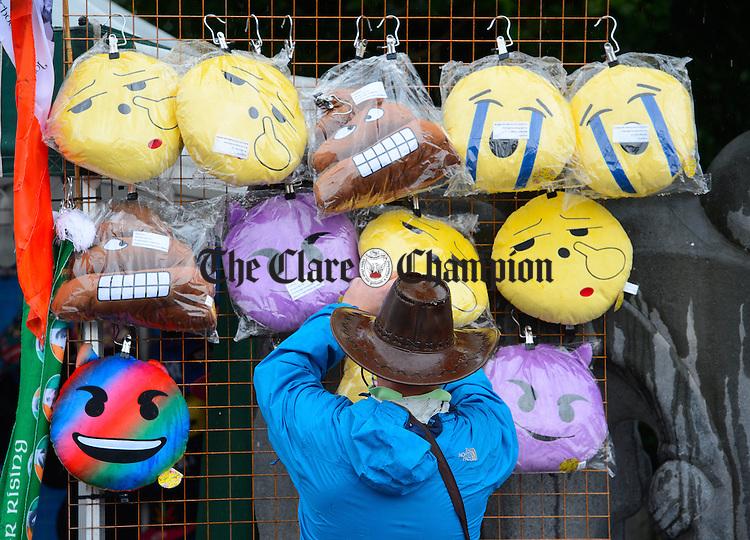 A street vendor organises his stall during Fleadh Cheoil na hEireann in Ennis. Photograph by John Kelly.