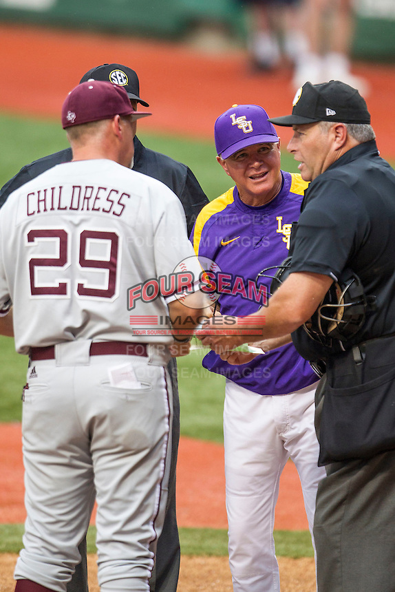 LSU Tigers Head Coach Paul Mainieri (1) meets with Texas A&M Head Coach Rob Childress (29) before a Southeastern Conference baseball game on April 24, 2015 at Alex Box Stadium in Baton Rouge, Louisiana. LSU defeated Texas A&M 9-6. (Andrew Woolley/Four Seam Images)