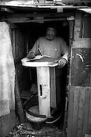 Montenegro  Novembre 2000.Campo profughi di Konik 1.Fami Adici,etnia rom ,52 anni falegname viene da Kosovo Polje, sposato  con 5 figli e 2 cognate un nipote, costruisce culle che vende a 10EUR.