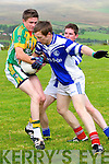 Lios Póil Gareth Noonan in an action against Annascaul James Scanlon and Gerard Farrelly during the County League Div. 3 match at the Lispole GAA grounds on Sunday afternoon.
