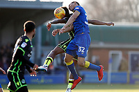 Darius Charles of AFC Wimbledon wins another header during the Sky Bet League 1 match between AFC Wimbledon and Bristol Rovers at the Cherry Red Records Stadium, Kingston, England on 17 February 2018. Photo by Carlton Myrie.