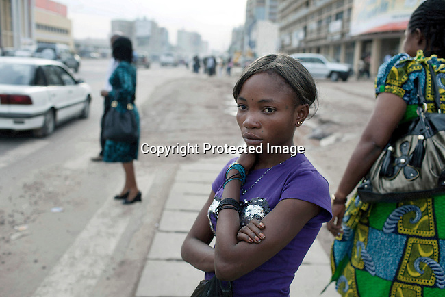 KINSHASA,DRC - NOVEMBER1: Esther Yandakwa, a 13-year old street child hangs out on the streets of central Kinshasa, DRC. She has lived on the streets since she was 6-7 years old and is dependent on prostitution to survive. She uses drugs and lives with a group of other homeless people in central Kinshasa. Thousands of children live on the streets of Kinshasa. Esther has been in and out orphanages or but she is only happy living in the mean streets of Kinshasa. (Photo by: Per-Anders Pettersson)