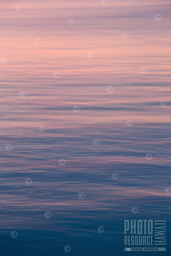 Colors dance on the water at sunset