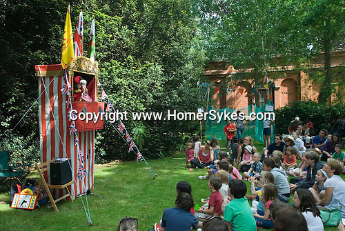 Punch and Judy Show at Petersham village fete Richmond Surrey. UK.