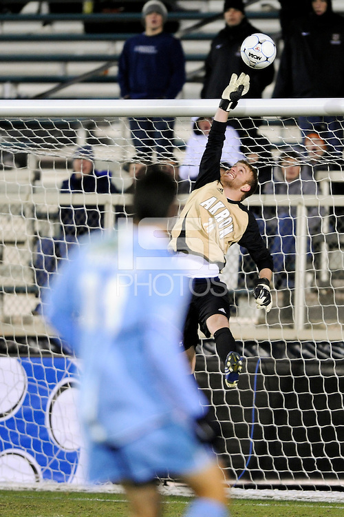 Akron Zips goalkeeper David Meves (24) pushes a shot over the bar. The Akron Zips defeated the North Carolina Tar Heals 5-4 in penalty kicks after playing a scoreless game during the second semi-final match of the 2009 NCAA Men's College Cup at WakeMed Soccer Park in Cary, NC on December 11, 2009.