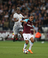 West Ham United's Joao Mario and Manchester United's Paul Pogba<br /> <br /> Photographer Rob Newell/CameraSport<br /> <br /> The Premier League - West Ham United v Manchester United - Thursday 10th May 2018 - London Stadium - London<br /> <br /> World Copyright &copy; 2018 CameraSport. All rights reserved. 43 Linden Ave. Countesthorpe. Leicester. England. LE8 5PG - Tel: +44 (0) 116 277 4147 - admin@camerasport.com - www.camerasport.com