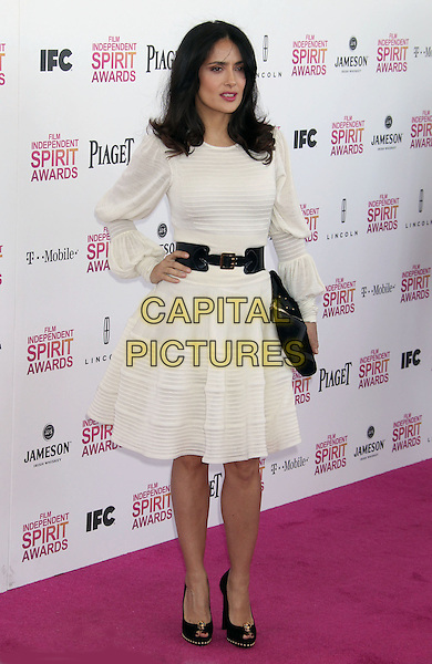 Salma Hayek.2013 Film Independent Spirit Awards - Arrivals Held At Santa Monica Beach, Santa Monica, California, USA,.23rd February 2013..indy indie indies indys full length cream white long sleeve dress black waist belt clutch bag peep toe shoes black hand on hip.CAP/ADM/RE.©Russ Elliot/AdMedia/Capital Pictures