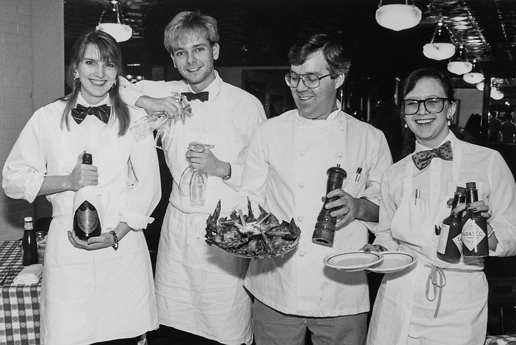 "Chef Molly Legath, Chef Jerry Fafaul, Kim Francarro, with Head Chef Kevin Cavanaueh presenting the ""Right Winner"" Special at the Station Grill on Jan, 18, 1990. (Photo by Maureen Keating/CQ Roll Call via Getty Images)"