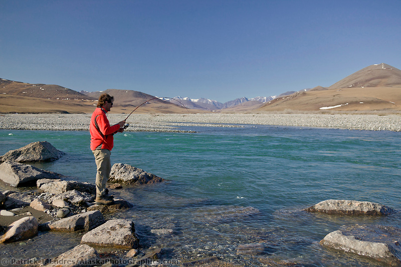 Fishing for Arctic char along the Kongakut River, Brooks Range mountains, Arctic National Wildlife Refuge, Alaska
