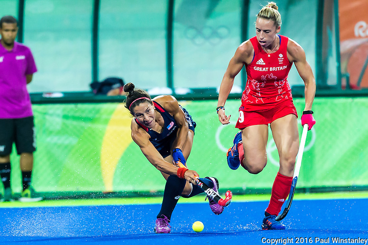 Melissa Gonzalez #5 of United States passes while closely watched by Susannah Townsend #9 of Great Britain during Great Britain vs USA in a women's Pool B game at the Rio 2016 Olympics at the Olympic Hockey Centre in Rio de Janeiro, Brazil.